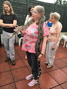 Picture of Annabel holding Quito the boa constrictor