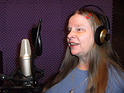 Picture of Annabel singing in the studio